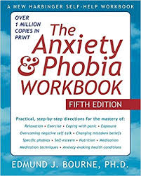 """Book cover with blue sky and white fluffy clouds with title """"The Anxiety & Phobia Workbook"""" by Edmund J. Bourne, Ph.D."""