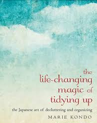 """Book cover with title """"The Life-changing magic of tidying up: The Japanese art of decluttering and organizing"""" by Marie Kondo"""