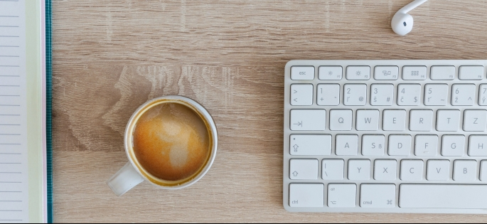 Keyboard and coffee mug